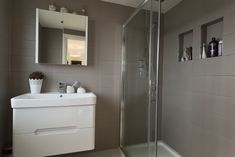 Neutral tiled ensuite in Loft Conversion South East London.  Constructed by Simply Loft.