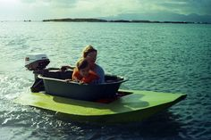 We took the bathtub boat to Sand Island to ride it around. We invited some friends,here's Malia and her mom Dani in 1973.