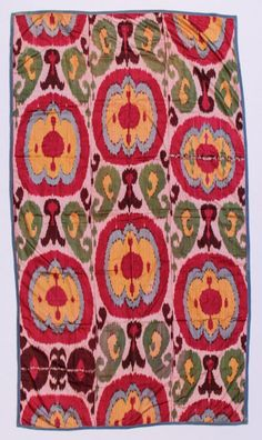 """All silk Uzbek ikat panel, six colors, circa 1900. Lined with Russian printed cotton. Two small inconspicuous repairs. Size: 83"""" x 46"""" (211 x 117 cm)"""