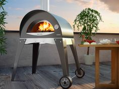 The Italian designed Alfa Forno Ciao features a brick hearth combined with steel dome. This provides Old World performance in a lightweight solution. GetdatGadget.com/alfa-forno-ciao-wood-fired-oven/