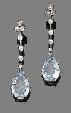 A pair of aquamarine and diamond pendent earrings. Each pear-shaped aquamarine…