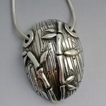 Stunning bamboo pendant by Lesley Messam.