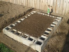 How to build a raised bed out of cinder blocks  Building a raised bed out of cinder blocks is easy and if you watch the local classified ads...