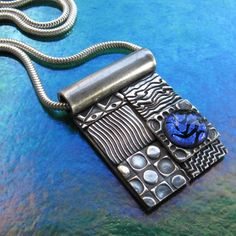 metal clay necklace with a dichroic cab