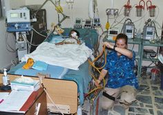 Inside ICUs around the world.. military ICU nurse drains young patient's chest tubes in Baghdad, Iraq