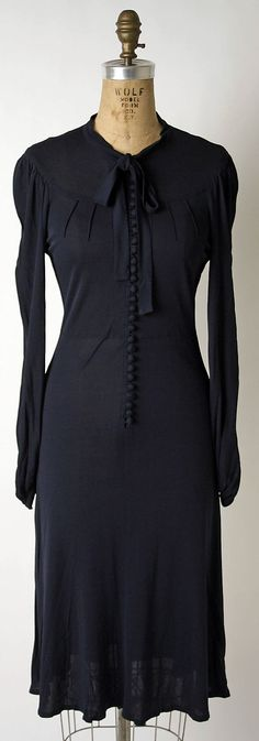 Jean Muir fall/winter 1972-73 - gorgeous black dress, love the buttons down the front