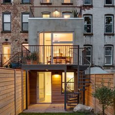 A two-storey extension with a glass wall overlooking a garden has been added to this slender brick row house in Brooklyn. See more images at http://ift.tt/1NMoYs6 #architecture #renovation #brooklyn by dezeen