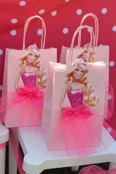 Take a look at gorgeous Barbie party favor bags that all girls are going to love leaving your party with. If you'd like to make your own print out an image of Barbie from the waist up and glow her onto a paper bag. Add the gorgeous finishing touch... the cute tulle skirt, topped off with a pretty pink bow. See more party ideas and share yours at CatchMyparty.com #catchmyparty #partyideas #barbie #barbieparty #barbiepartyideas #teenparty #girlbirthdayparty