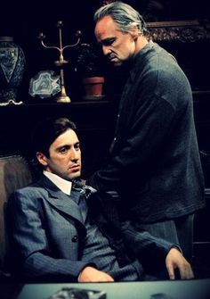 The Godfather - Michael Corleone as the Don and his father Vito retired and acting as advisor. Just love the look of evil on Michael's face.