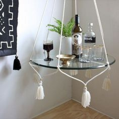 Hanging Table/Plant Holder with Tassels - Cream Cotton Our designer Angie is a huge fan and collector of pretty much anything that you can hang from the ceiling, so she decided it was time to create a version of the classic macrame hanging table. Diy Hanging Shelves, Hanging Table, Glass Shelves, Curtain Hanging, Macrame Curtain, Hanging Plants, Decoration Ikea, Decoration Design, Hanging Decorations
