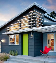 """The siding and eaves/fascia are Benjamin Moore colors. The siding is Graphite (#1603) and the eaves and the fascia are Gunmetal (#1602). The stucco is the best match for Benjamin Moore color Timberwolf (#1600). THe door is Benjamin Moore's """"Tequila lime"""" #2028-30, semi gloss."""