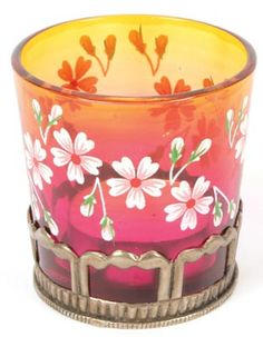 £5.00 Pretty tealight holder with pink glass and delicate flowers, handmade in India. Take a closer look... http://www.thefairtradestore.co.uk/fair-trade-homeware/candles-holders/tealight-holder-with-pink-glass-and-flowers/prod_527.html  #Fairtrade #Tealights #India #Handmade #Home