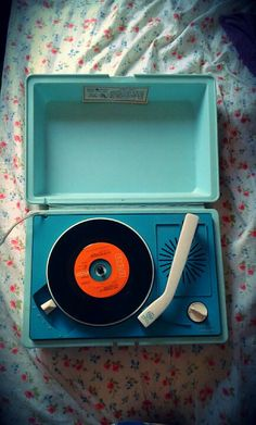 This is the exact record player I had when I was young.