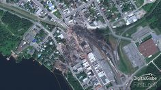 Rail disaster occurred on 6th July 2013 in Lac-Megantic, a town of Canadian province of Quebec at 01:15 EDT. Train carrying Bakken formation crude oil derailed, resulting fire and explosion. 42 people died and several injured and more than 30 building were destroyed.  GeoEye-1 Captured the hazard on 13th July, 2013 showing disaster site and vulnerable area.  Image © DigitalGlobe. SATPALDA is a privately owned company and authorised reseller of satellite imagery of DigitalGlobe.