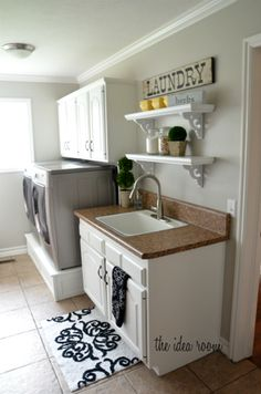 Laundry Room - Raised washer/dryer, cabinets, and sink (possibly add sorting station, drying rack, and fold down ironing board)
