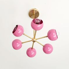 Mid Century Modern inspired small chandelier in bright pink with brass accents Pink Chandelier, Chandelier Bedroom, Sputnik Chandelier, Chandelier Lighting, Midcentury Modern, Modern Interior, Interior Design, Mid Century Modern Chandelier, Mid Century Modern Bedroom