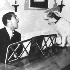 'Cary Grant and pup, singing.'