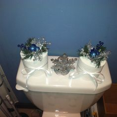 Put Christmas appliqués through extra toilet paper rolls! Great idea and cheap.