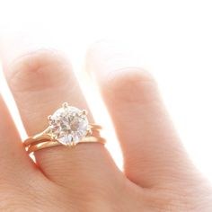 The Marilyn Vintage Engagement Ring features an EGL certified 2.80 carat Old European Cut Diamond in a six prong 18 kt yellow gold solitaire setting. The diamond has been graded in the setting as L-M color VS1 clarity. It has been assigned an appraisal value of $27,170 by the EGL. With the purchase of this ring comes a full EGL Report (number US 312446801D) and appraisal.The diamond faces up very bright! Currently a size 7.5 and can be sized. Why We Love It  The diamond in this ring is…