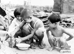 Amidst the wreckage of city buildings in Tokyo, these Japanese children still contrive to amuse . Nagasaki, Hiroshima, Enola Gay, City Buildings, History Books, Ww2, Little Boys, Prompts, Tokyo