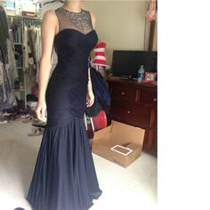 Beaded mesh sleeveless evening gown! Mermaid style, shows the body off beautifully. Dark navy color. Worn once to a prom! Perfect condition. By far my fav dress.