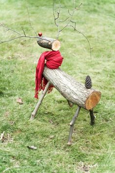 A DIY reindeer made from tree branches and logs! Check out this full tutorial on how to make a Christmas reindeer by Designer Trapped in a Lawyer's Body! Reindeer Logs, Diy Christmas Reindeer, Red Christmas Ornaments, Wooden Snowmen, Christmas Post, Homemade Christmas, All Things Christmas, Christmas Crafts, Christmas Ideas