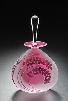 Art Glass Perfume Bottle created by Mary Angus - Etched fern leaves dance on the clear, sandblasted surface of this hand blown glass bottle, highlighting the pink interior. Just so fine....