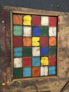 Multicolored scrap wood in frame.  Rustic, Farmhouse, Reclaimed, Repurposed Furniture & designs.