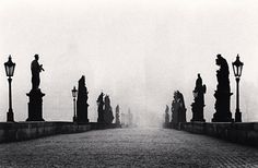 Here is a photo of a bridge in Prague, Czechoslovakia taken by Michael Kenna. This photographer uses shadows to express the depth of the locations he visits, mentally taking his viewers there with him. http://www.photographymonthly.com/Tips-and-Techniques/Pro-Zone/Michael-Kenna-The-Master-of-landscape