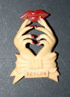 Vintage celluloid Revlon hands and lips pin