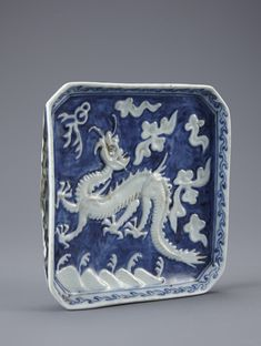 (Korea) A Blue and White Porcelain Plate with a dragon motif. circa 19th century CE. Joseon Kingdom, Korea.