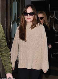 Specs appeal!Donning a pair of cat eye sunglasses and slinging a Chanel cross body bag over her shoulder, the pretty brunette put on a typically chic display as she made her way into the studio