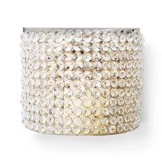 """Bling Sconce from Z Gallerie, $69.95  It's hard to imagine that more elegance can sparkle from crystal, but it's possible with our Bling Sconce. Made of handcrafted polished nickel that connects strands of genuine crystal, a candle of your choice can take the natural bling of crystal to the next level.    7.5""""H x 9""""W x 5""""D"""