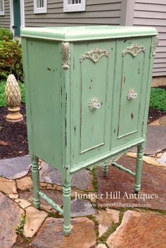 A repurposed music cabinet newly painted and heavily distressed.