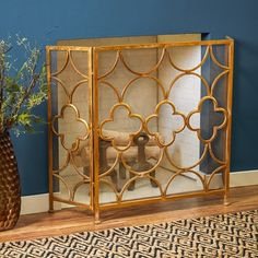 Featuring a quatrefoil-inspired motif and a luxe gold finish, this iron fireplace screen is an unexpected scene-setter for a glamorous living room or lounge space. Gold Fireplace Screen, Modern Fireplace Tools, Brick Fireplace Makeover, Fireplace Screens, Living Room With Fireplace, Fireplace Mantels, Fireplaces, Living Rooms, Metal Fireplace