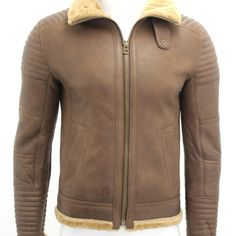 Hermes Chestnut Brown Mens Biker Bomber Warm Shearling Sheepskin Leather Jacket Product Details: Stitched sleeves, shoulder and back panel which makes the jacket very trendy. Single breasted design Heavy duty brass zip Buckle strap under collar Soft touch 1″ wool throughout Nappa lamb finish Biker style sheepskin jacket Hand cut using tanned skins Angle Side hand warmer pockets Authentic and original tanned skins