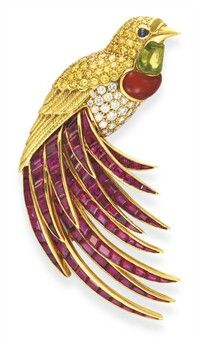 A MULTI-GEM 'BIRD OF PARADISE' BROOCH, BY VAN CLEEF & ARPELS   Designed as a circular-cut diamond body, with a circular-cut yellow diamond head and cabochon sapphire eyes, to the cabochon peridot and carnelian throat, extending textured gold wings and a spray of calibré-cut ruby tail feathers, mounted in 18k gold   Signed V.C.A. for Van Cleef & Arpels, N.Y