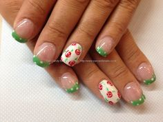 Green and white polka dots with freehand rose nail art