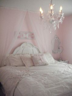 Ok...so this might be the girly look I am going for in my room do-over...perhaps just a bit more peachy, and a different bed, but cute and feminine!