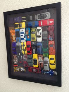 Matchbox/hotwheels cars shadow box. These are some of my sons hand picked favorites. :)