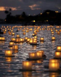 """straight out of fantasy.doesn't it look like that scene in """"Tangled"""" where Flynn and Rapunzel are floating on the river? Except the lanterns are floating on water, not floating to the sky."""