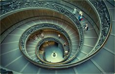the grand staircase of the vatican museums