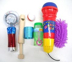 """Reinforcer Kit - to provide a selection of products that many children diagnosed with autism would not only want to play with but would be willing to """"work for"""" during their one-on-one intervention. Contains: A Spinning Light Up Meteor Storm (battery operated), a Flashing Spinning Top, Wooden Slide Whistle, Magic Mic (an Echo Microphone), Plastic Rainbow Magic Spring, Squishy Spagehetti Ball and Bubbles."""