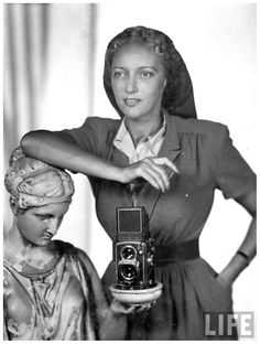 LIFE photographer Nina Leen posing with Rolleiflex camera 1949, by her husband, photographer Serge Balkin