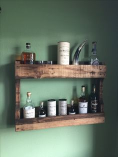 Rustic whisky shelf made from an reclaimed pallets.