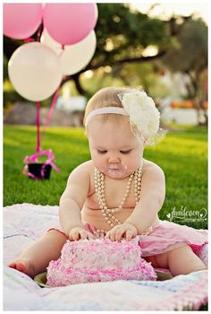 Photograph option for a one year old complete with pearls and smash cake.  See more first girl birthday party ideas at www.one-stop-party-ideas.com:
