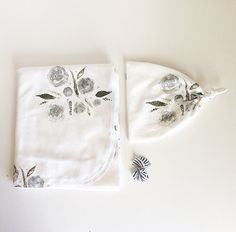 This listing is for a grey watercolor floral swaddle print and a matching knotted beanie! Exclusive print to Finn and Olive. The organic material is