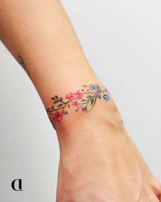Tats 30 Captivating Tattoos You Will Fall in Love With - bemethis Arm Band Tattoo For Women, Wrist Band Tattoo, Wrist Bracelet Tattoo, Cute Tattoos For Women, Tattoos For Women Flowers, Flower Wrist Tattoos, Small Wrist Tattoos, Arm Tattoo, Tattoo Small