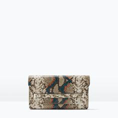 Bought this! After my trip to Austin, I can't keep my eye off snakeskin. Love that the pattern is delicate and edgy at the same time. Can't wait to take this out for a spin!  ZARA - WOMAN - EMBOSSED CLUTCH