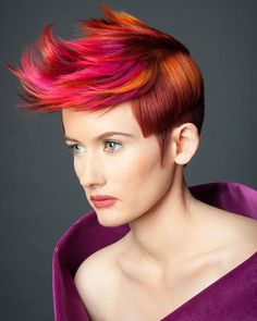 Man, I LOVE the amazing color they did on top of her hair! And the cut is very striking, but difficult to keep up. Great hair.